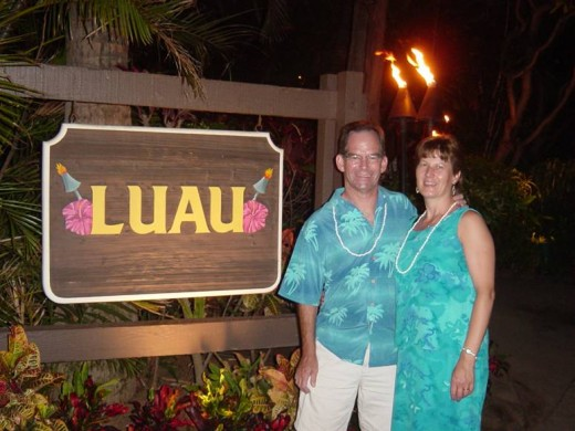 Celebrating our 25th wedding anniversary at a luau in Hawaii