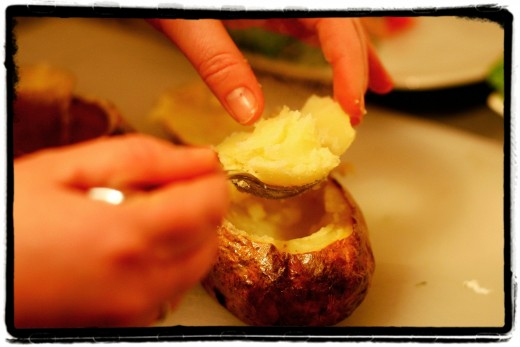 Spoon out the cooked potato into the bowl with the Spinach and Ricotta