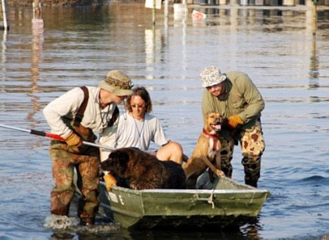Individuals from a pet rescue group help the animals during the aftermath of Hurricane Katrina.