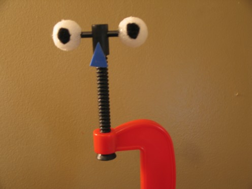 a 'c' clamp with personality! a simple toy clamp with some styrofoam balls and felt - from a toy box to a stage near you!