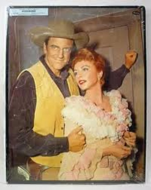 "JAMES ARNESS ""MATT, EMBRACES AMANDA BLAKE, ""KITTY."""