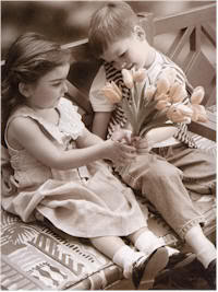 Little boy gives flowers to a little girl---and they call it Puppy Love.