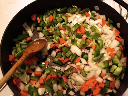 11.  Now start cooking your onion, carrots, and green peppers.