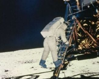 "Neil Armstrong prepares to step onto the moon.  ""That's one small step for man, one giant leap for mankind."""