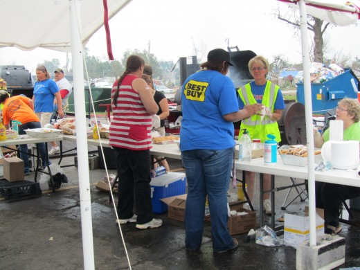 Free food offered by combined churches for survivors and volunteers.