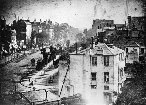 Boulevard du Temple by Daguerre.  This is the photo with the person, can you see him?