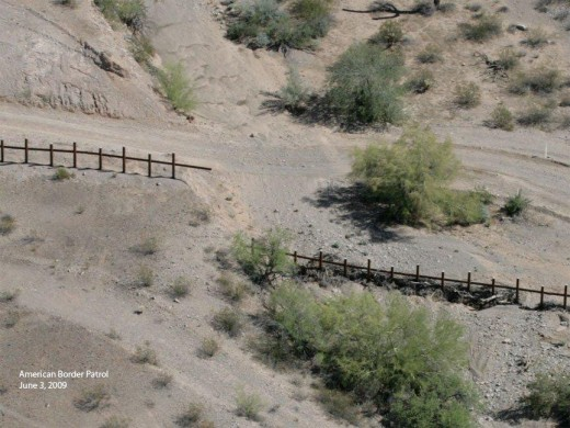 Vehicle barriers on the Arizona-Mexico border at Oregon Pipe National Monument west of Lukeville.  (Photo used with permission of American Border Patrol).