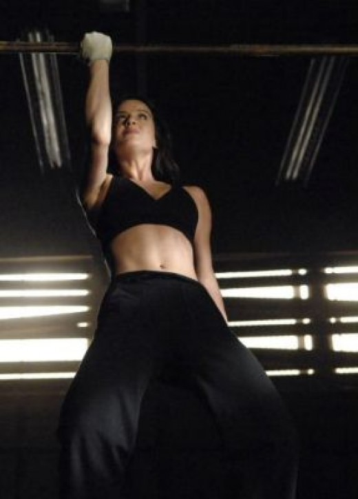 Remember the Bionic Woman television show? Well it was re-made for modern times. Actress Michelle Ryan is seen here getting in shape for the role. Nice one arm pull-up.