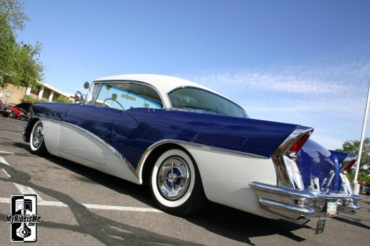 OWNED A '56 BUICK. BUT NOT IN THIS COLOR. OTT'S WAS JET-BLACK. SHINED LIKE A NEW PENNY. AND HAD A HORN THAT COULD BE USED AS A SIREN TO WARN AGAINST BOMBING ATTACKS.