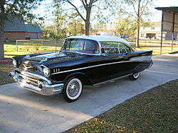 "A BEAUTIFUL '57 CHEVY BEL AIR. WITH FENDER SKIRTS, 283 CUBIC INCH ENGINE, LUXURIOUS INTERIOR AND A TRUE ""CHICK MAGNET."""