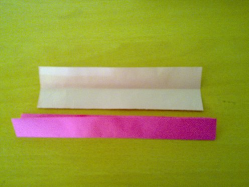 Step 3- fold pink paper in to half