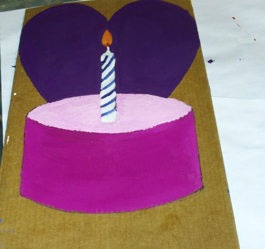 I used purple acrylic paint to fill in the heart behind the cupcake.