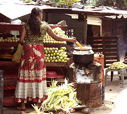 Boiling corn.