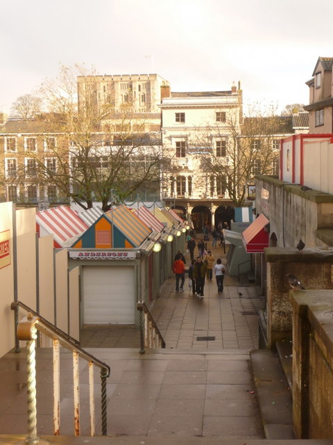 Norwich Market, with colourful stall roofs.  Facing is the Royal Arcade, while the Castle can be seen in the distance, to the left.