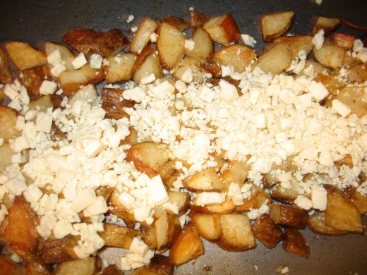 Gorgonzola cheese sprinkled over roasted potatoes
