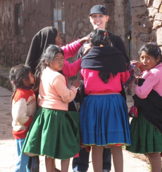 Me, being mobbed by children in Lake Titicaca