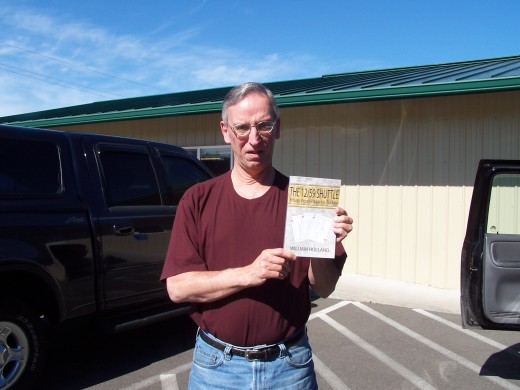 The author with his self-published novel