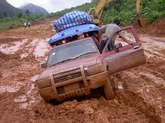 THIS CAR IS 'IN A RUT,' OR WAS. NOW IT'S STUCK FAST IN THE MUDDY GROUND. DOES THIS REMIND YOU OF YOUR LIFESTYLE?