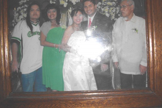 In this wedding picture of my daughter; My son, me, my daughter, her groom, their father (my ex)