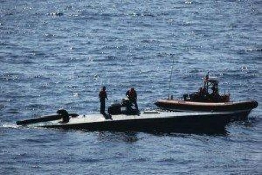 US Coast Guard members inspect a seized SPSS off the coast of Central America.