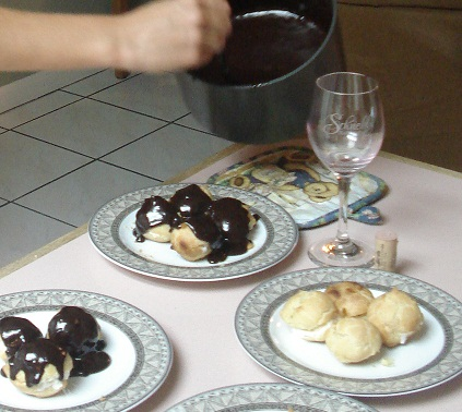 Choux being drizzled with Organic Chocolate Sauce (ganache)