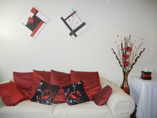 I love the beauty of simplicity when it comes to home decor.  And I love the combination of black, white and dark red.