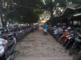 Bekasi commuters deposit their cars and motorcycles at  parking lots provided while they go to work in Jakarta by train.