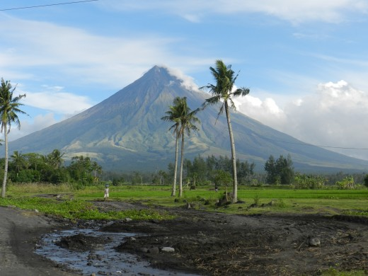 View from the river valley below, which has seen Mayon's beauty and its destructive force.