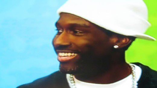 Shawn Stockland of Boyz II Men smiles as he watches Wanya eat.