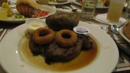 For dinner, I decided to have the succulent Rib Eye, topped with crisp onion rings and a baked potatoe.