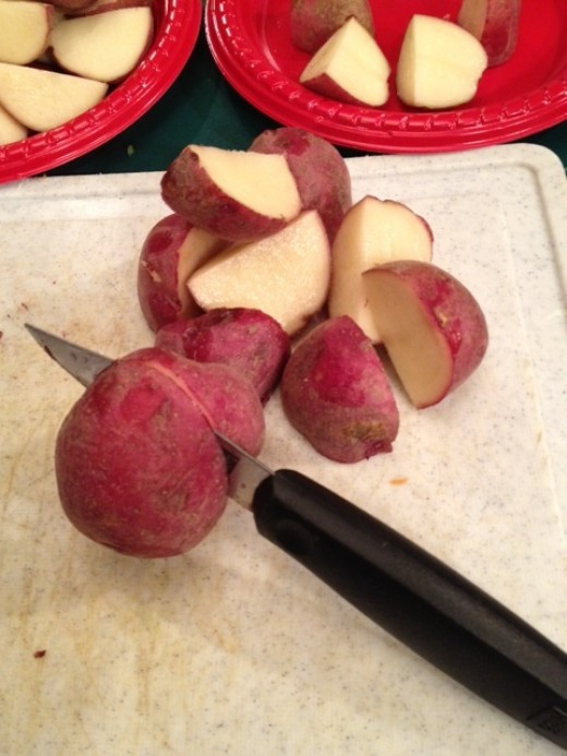 Cut potatoes in to chunks the size of the stew meat (in this case i cut the small red potatoes into 1/4's)