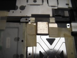 Sticking the metal plate to the plastic cover.