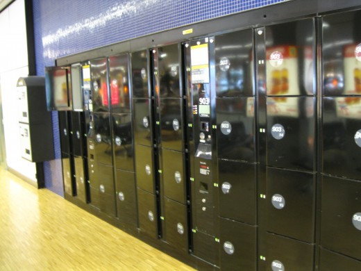 Amsterdam Airport Schiphol temporary storage lockers.  Fee for medium locker is 6 Euros per 24 hours.