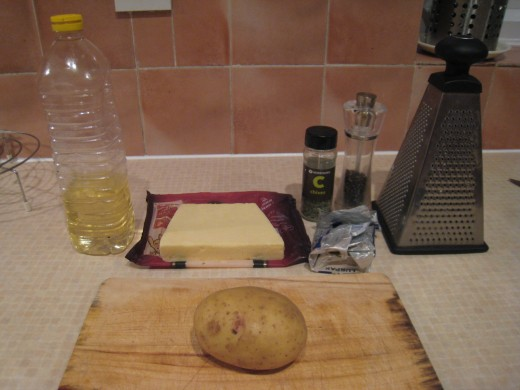 Getting ready: Jacket potato, chopping board, olive oil, cheese, pepper chives, butter, cheese grater