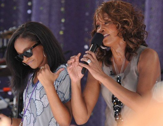 "American singer Whitney Houston performing ""My Love Is Your Love"" with her daughter Bobbi Kristina Brown on Good Morning America (Central Park, New York City) on September 1, 2009."