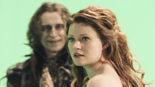 "Belle (Emilie de Ravin) agrees to go with Rumplestiltskin (Robert Carlyle) as part of a deal to save her village in ""Skin Deep"", the Valentine's Day episode of ""Once Upon a Time""."