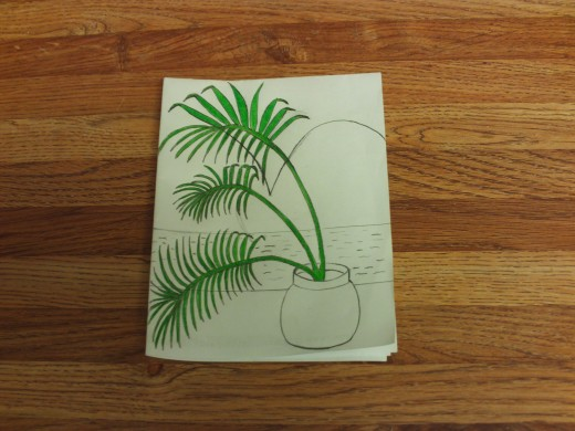 I colored in the palm trees with a green colored pencil.