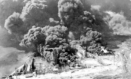 Refineries and oil storage tanks of the Monsanto chemical plant burn in the waterfront area in Texas City, Texas, April 16, 1947.