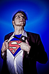 """CLARK KENT, SUPERMAN'S ALIAS, SOMETIMES STEALS AWAY BY HIMSELF TO PRACTICE PULLING OFF HIS SHIRT TO EXPOSE THE FAMOUS """"S"""" MEANING SUPERMAN."""