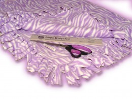 This is a finished purple tiger striped fleece blanket. The fringe is done in style 2. You can see how it lays nice and looks great!