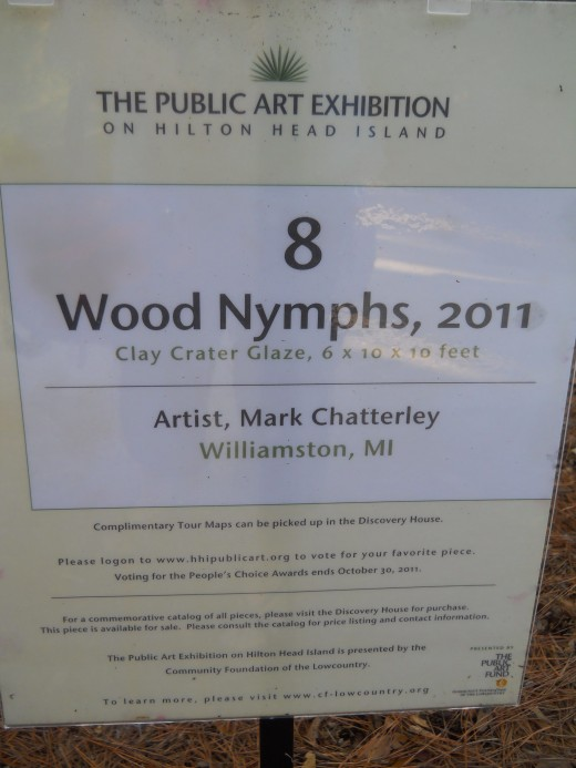 Wood Nymph Sculpture sign.