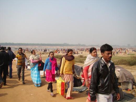 Pilgrims crossing Ajoy through a fair-weather bridge