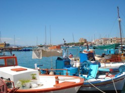 Colourful fishing boats in the harbour of Aegina city.
