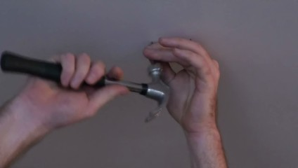Use finishing nails to find the edges of the stud without leaving big holes in your ceiling. Tiny holes can more easily be patched, if desired.