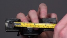 Measure the distance between the holes on your ceiling mounting bracket.