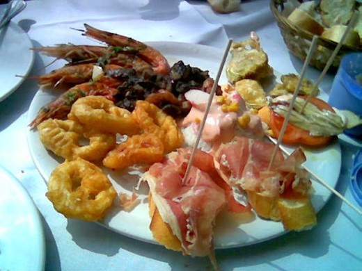 "A sample of Spanish ""Tapas"" ~ small servings meant to be shared by everyone at the table.These are NOT the tapas we ate, but merely a picture to give you the idea of what we had!"