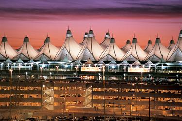 Denver International Airport main terminal at night.