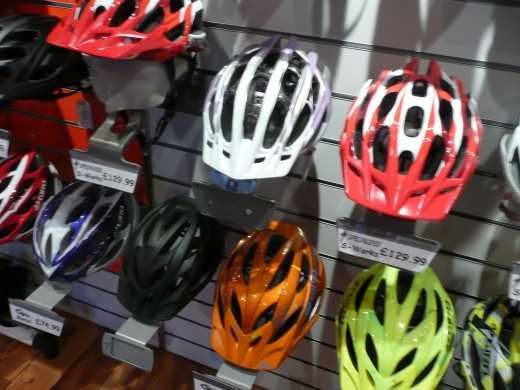 Different sizes, shapes and colours of mountain bike helmets.