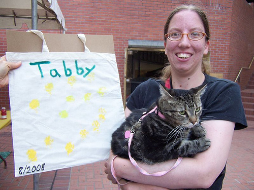 Tabby, with human mom Karen, showing off her pawprint artwork