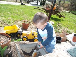 My grandson Colton playing with his toy trucks.
